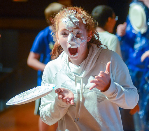 """Selinsgrove Middle School student Hailey Beaver after Brenda Folio, a science teacher at middle school, throws a pie back Beaver's face during the school's """"Torment a Teacher"""" event."""