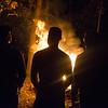 Members of the MIdd-West Football team gather around a bon-fire behind the Paxtonville United Methodist Church on Thursday evening.