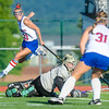 Selinsgrove's Megan Hoffman leaps over Wyoming Valley West's goalie, Sydney Rusncok, after making an assist to Morgan Ruhl that tied Tuesday's game in Selinsgrove.