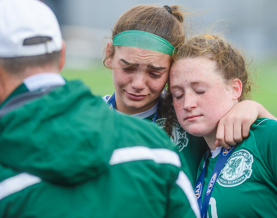 Lewisburg's Sarah Burns and Chloe Michaels lean against one each other during the medal ceremony for the state championship on Saturday. Lewisburg lost to Bedford in overtime from a penalty kick.