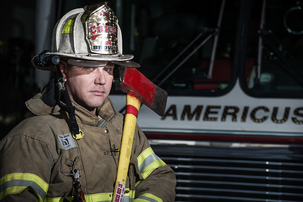 Chief Paul Brown of the Sunbury Fire Department stands in front of the Americus fire truck.