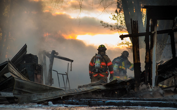 Firefighters work in the destroyed garage at 1818 Park Road in Winfield.