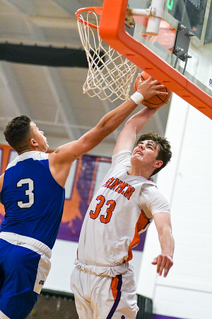 Danville's Dyson Harward has his dunk blocked by Central Mountain's Collin Jones during Tuesday night's game.