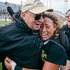 Southern Columbia's head coach, Derek Stine, hugs a crying Sami Palacz after Palacz scored the gaming winning overtime goal against Freedom during the state championship on Friday in Hershey.