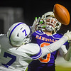 Danville's Peyton Riley goes for a catch while being defended by Shamokin's Wolfgang Pearson during Saturday night's district playoff game.
