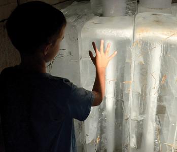 Luke Wagner, 9 Danville, feels a block of ice inside the ice house by The English Garden in Riverside on July 17, 2014.