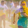 Timothy Feese covers his mouth while going through paint stations during the JROTC Color the Valley 5k Paint Run on Saturday in Sunbury.