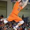 Bucknell's D.J. MacLeay hangs on the rim after slam dunking a ball against Army on Saturday night.