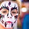 Miles Purcel, 6 of Northumberland, shows off his painted face during the Danville Fall Arts and Crafts on Saturday.