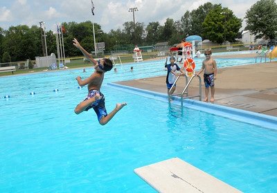 Christopher Reber, 8, takes advantage of open space with brother Matthew, 10, and friend, Mikey Lesher, 8, at the Mifflinburg Community Pool Friday July 27, 2012.