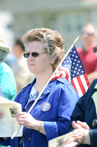 Diohn Fouts, Selinsgrove, listens on during a ceremony on Monday re-dedicating a memorial for Gov. Snyder on Memorial Day.