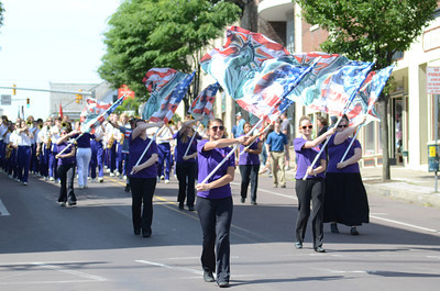 Members of the Danville High School marching band color guard twirl their Statue of Liberty flags during Danville's Memorial Day Parade on Monday.