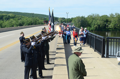 Color guard members from the Danville American Legion Post 40 give a salute on the Danville-Riverside bridge on Monday during a ceremony before the start of Monday's Memorial Day Parade in Danville.