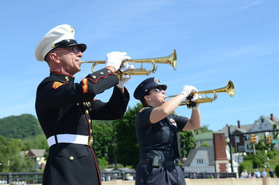 Andrew Georges, left, and his daughter Larrissa Georges, play taps to conclude a ceremony on Monday in Danville before the start of Danville's Memorial Day Parade.