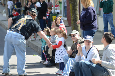 Veteran Grant Fritz, left, shakes the hand of Abbi Smith, 4, Danville, during Monday's Memorial Day Parade in Danville.