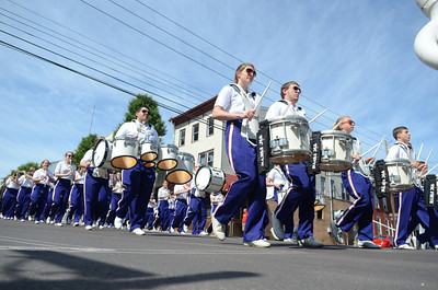 The Danville Marching Band makes its way down Mill Street on Monday while performing in the Memorial Day Parade.