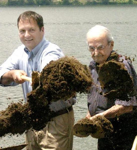 Former U.S. Rep. Chris Carney, D-10, of Dimock, left, and state Rep. Merle Phillips, R-108, of Sunbury RD2, cast a shovelful of dirt during groundbreaking of Sunbury's riverfront stabilization and enhancement project in June 2010.