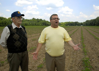 Northumberland County commissioners, Merle Phillips and Vinny Clausi, discuss the use of 88 acres of land along the North Branch of the Susquehanna River in Point Township in June , 2011.