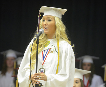 "Carly Smith sings ""Go The Distance,"" during Wednesday night's commencement at Millersburg Area High School."
