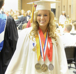 Tori Fulkroad smiles as she spots family members in the crowd during Millersburg Area High School's Commencement on Wednesday.