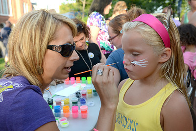 Rainlynn Nowlen, 7, of Northumberland watches the brush as Leslee Maturani adds wiskers at the Children and Youth table at National Night out in Sunbury Tuesday August 7, 2012.
