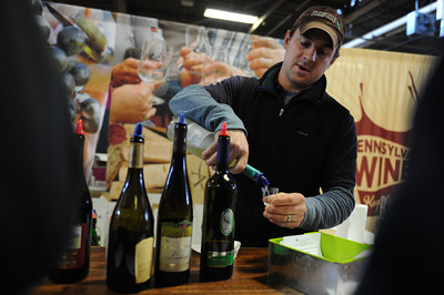Bill Zimmerman, of Shade Mountain Winery, pours a sample during the PA Farm Show on Tuesday afternoon in Harrisburg. The winery won two silver medals and six bronze medals for their wines this year at the show.