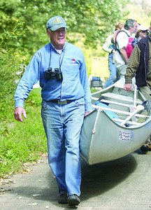 Bill Gibson, organizer, takes his cannoe down to the Susquehanna River on Sunday for Grove Presbyterian Church's River Float.