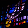 A dove in a modern stained glass window at Zion Lutheran Church.