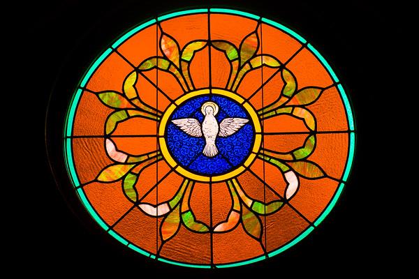 A window at Catawissa Avenue United Methodist Church showing a dove.