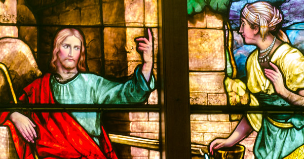 Jesus with the Samaritan woman depicting on a stained glass window at Otterbein United Methodist Church.