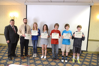 Donald Steele, left, president and ceo of Northumberland National Bank, stands with Milton Middle School teacher Seth Reitz and members of his winning stock market game team for the middle school division, Jenelle Griffin, Austin Swallow, Ian Lilley, Gavin Walker, and Dylan Birdsong.