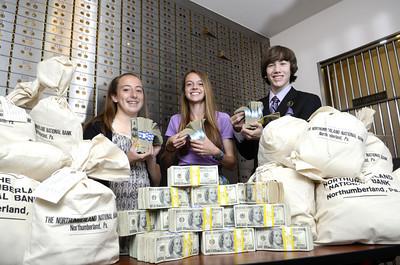 Lewisburg High School freshman Madi Kratzer, left, Nate Reid, Jenna Farmer.
