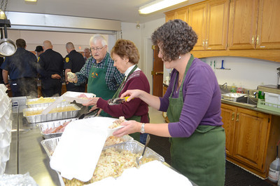 Lu Natter, left, of State College and his wife Susan, help along side Berta Hickox of Lewisburg, boxing up takeout meals for the First Presbyterian Church's Thanksgiving dinner in Lewisburg on Thursday.