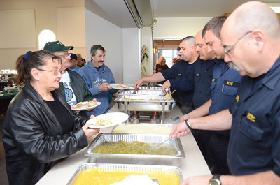 Members of the Lewisburg Fire Department help serve up a Thanksgiving day dinner at the First Presbyterian Church in Lewisburg on Thursday.