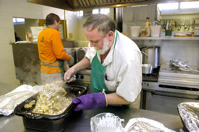 Mike Bialecki, Danville, helps get the Thanksgiving dinner ready at St. Josephs Church in Danville on Thursday morning.
