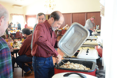 Joe Koletar of Selinsgrove helps with the Thanksgiving dinner at the All Saints Episcopal Church in Selinsgrove on Thursday.