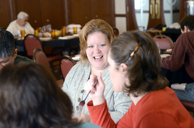 Alexis Matteo, left, Selinsgrove, and Amanda Range, Selinsgrove, share a laugh over a Thanksgiving dinner at the All Saints Episcopal Church in Selinsgrove on Thursday afternoon.