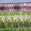 Selingrove Cheerleaders Margie Lamon, Corrine Smith, Pat Hughes, Helen Redcay, Jackie Brungart and Kay Bolig stand in front of the Selinsgrove Area High School.