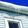 "Jan. 4,2013<br />  Taken yesterday in bright sun. Cloudy and very cold today!  I left this crop because I like the reflection in the window. The home owner  asked if there was something wrong with her roof after she saw me focusing from the sidewalk.  Just gorgeous icicles ; so she said ""wow take as many as you like"" and Happy New Year!"