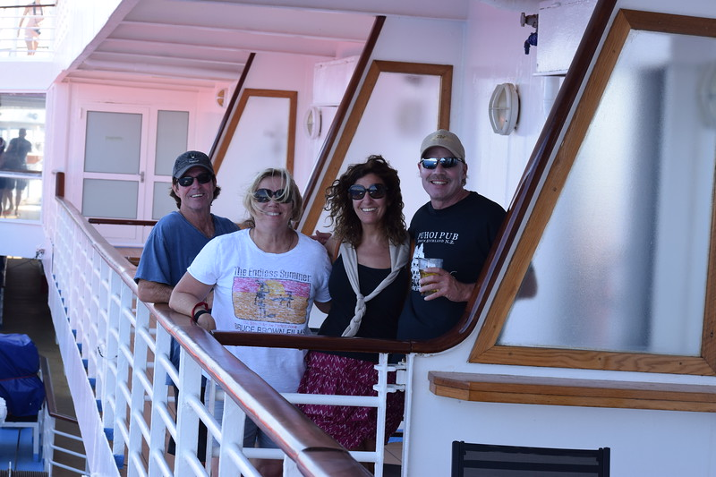 Jackson, Cathy, Kerri (Tour Manager) and John on one of our balconies for a viewing party of the first glimpse at the island of Santorini