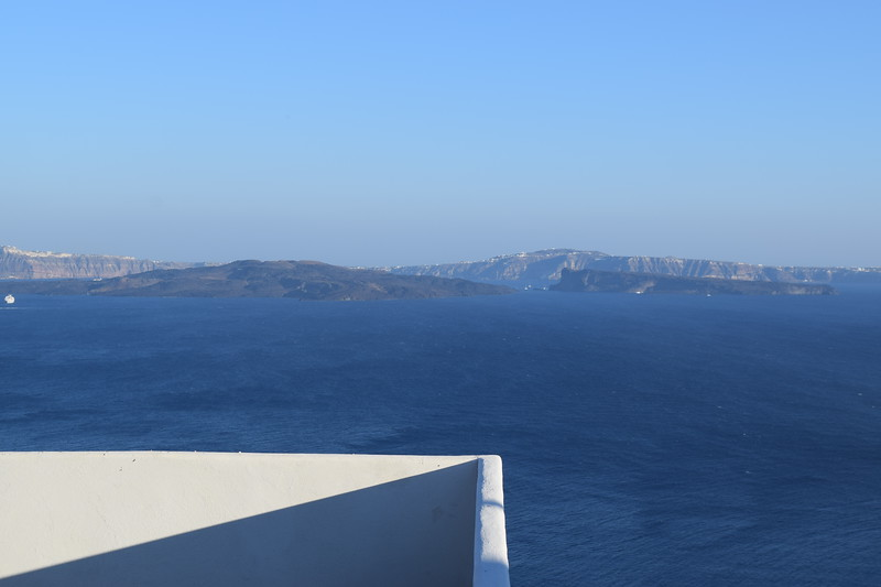 These 2 small dark islands were created by the active volcanoes in the port of Santorini