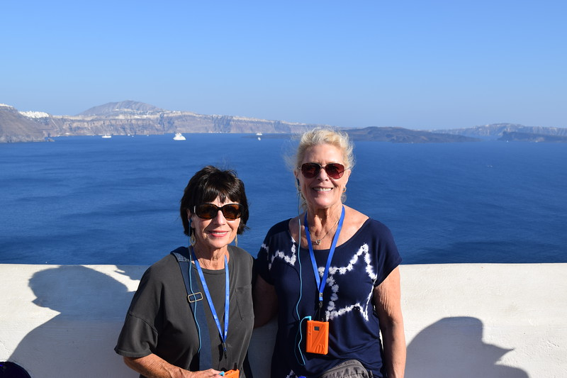 Beautiful view, foreground (Patty and Patsy) AND background, port of Santorini
