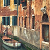 Small Boat on a Canal in Venice, Italy