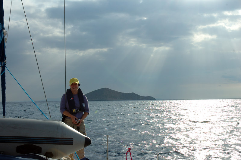 Close to Patmos.  Gayle standing watch on starboard side. My face hurt from smiling - ear to ear - the whole trip.