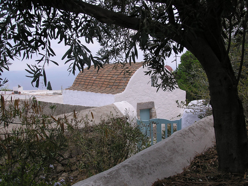 View of back of house with fence, gate and the Agean