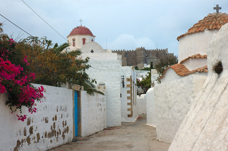 Typical road and traditional blue door. Monestary in back ground which we hope to get to.