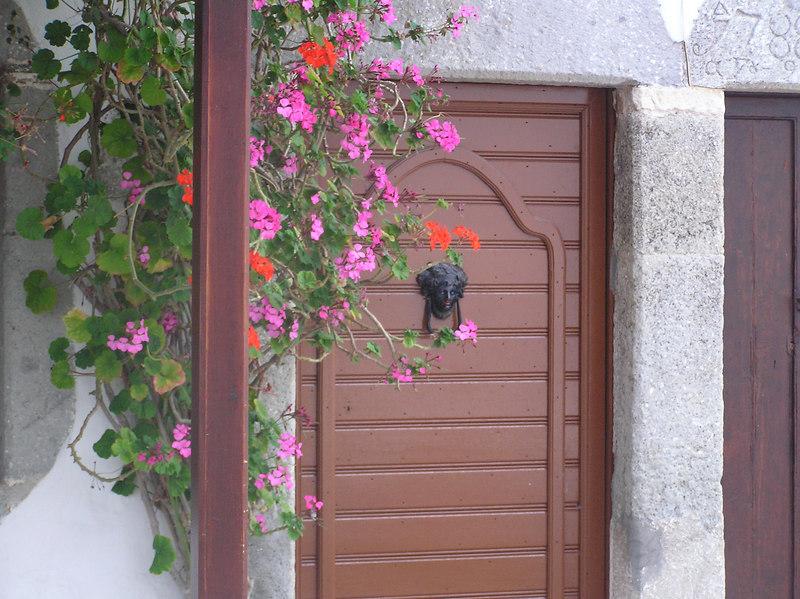 Art - Door knock.  Face of one of the saints.