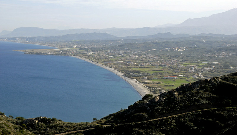 Looking east to Maleme airstrip from west of Kolimbari, Crete, 26 December 2009 1.  The airfield whose capture by the Germans determined the Crete campaign is on the promontory in the middle distance at left.