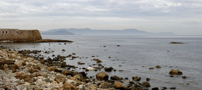 Looking west along the harbour wall towards the Rodopos Peninsula, Chania, Crete, Christmas Day 2009