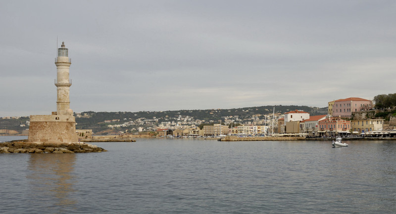 Lighthouse and harbour from the west, Chania, Crete, 26 December 2009 1.     The lighthouse was built by the Venetians in the 16th century, and rebuilt in minaret form in the 1830s when Crete was ruled from Egypt.